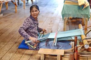 Lady weaving 1