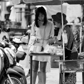 Lady buying from Vendor
