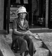 Vietnamese lady outside her shop